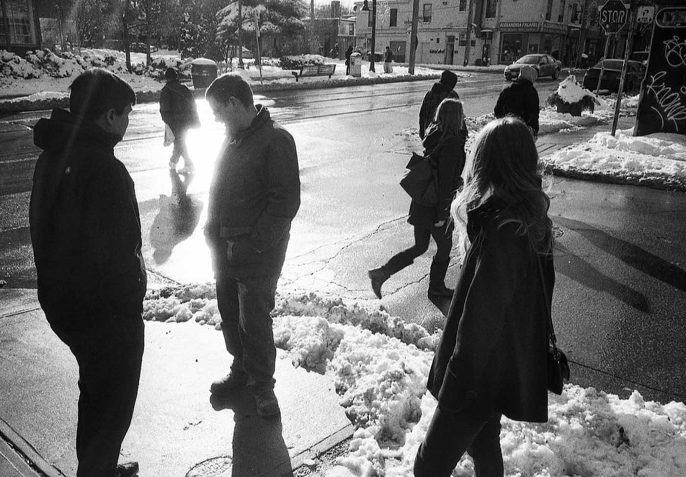 Members of the Agency Dominion team on the sidewalk in the winter time